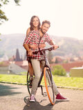 Beautiful young couple on a bicycle smiling Stock Images