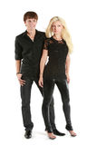 Beautiful young couple in black shirts on white Royalty Free Stock Image
