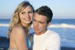Beautiful young couple on the  blue beach Stock Image
