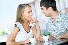 Beautiful young couple at cafe Stock Image