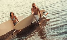 Couple standup paddle boarding Stock Images