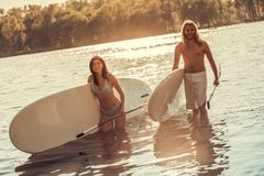 Couple standup paddleboarding stock photography