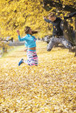 Beautiful young couple celebrate and jumping after successful training in the park Royalty Free Stock Photos