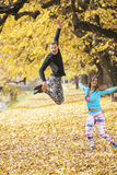 Beautiful young couple celebrate and jumping after successful training in the park Royalty Free Stock Photography