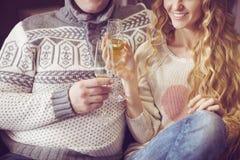 Beautiful young couple celebrating christmas drinking champagne Stock Image
