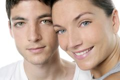 Beautiful young couple closeup portrait over white Stock Photo