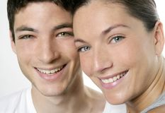 Beautiful young couple closeup portrait over white Royalty Free Stock Images