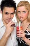 Beautiful young couple with cocktails. Isolated Royalty Free Stock Photo