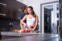 Beautiful young couple in the kitchen Stock Photos