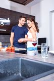 Beautiful young couple in the kitchen Royalty Free Stock Photos
