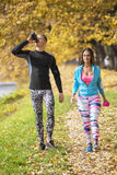 Beautiful young couple cooling down after running in the park. Stock Photography