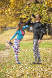 Beautiful young couple cooling down after running in the park. Stock Photos