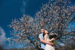 Beautiful young couple dancing and having fun on blue sky background Royalty Free Stock Photos