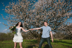 Beautiful young couple dancing and having fun on blue sky background Stock Photos
