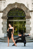 Beautiful young couple dancing outdoor in park Royalty Free Stock Photography