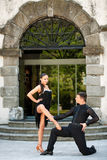 Beautiful young couple dancing outdoor in park Stock Photos
