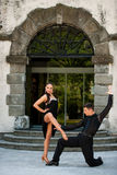 Beautiful young couple dancing outdoor in park Royalty Free Stock Images
