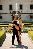 Beautiful young couple dancing outdoor in park Royalty Free Stock Image