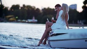 Beautiful young couple drinking champagne on floating boat stock video footage