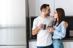 Beautiful young couple drinking coffee royalty free stock images
