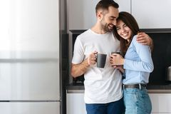 Beautiful young couple drinking coffee royalty free stock photo
