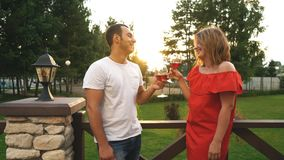 Beautiful young couple drinking wine on a terrace stock video