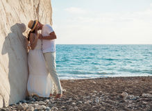 Beautiful young couple embracing near the rock Stock Photography