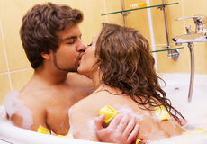 Beautiful young couple enjoying a bath Stock Images