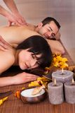 Beautiful young couple enjoying massage Stock Image