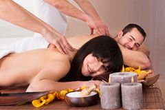 Beautiful young couple enjoying massage. In Spa Centre Royalty Free Stock Image