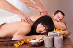 Beautiful young couple enjoying massage Royalty Free Stock Image