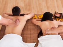 Beautiful young couple enjoying massage. In Spa Centre Royalty Free Stock Photography