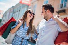 Young couple enjoying in shopping, having fun in the city stock image