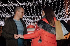 Beautiful young couple enjoying in shopping at night royalty free stock images
