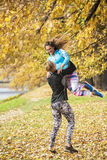 Beautiful young couple enjoying together in the park. Autumn environment Stock Photography