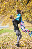 Beautiful young couple enjoying together in the park. Autumn environment Stock Image