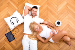 A beautiful young couple on the floor in their new home Royalty Free Stock Photos