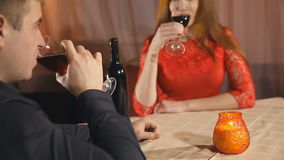 Beautiful young couple with glasses red wine in luxury restaurant stock video footage