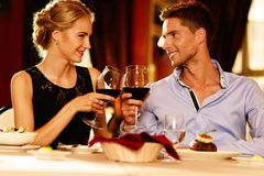 Beautiful young couple with glasses of wine Stock Photography