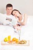 Beautiful young couple having breakfast. Stock Photos