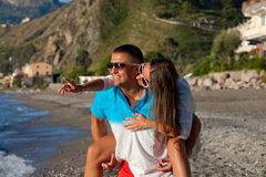 Beautiful young couple having fun on the beach Stock Image