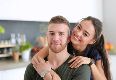 Beautiful young couple is having fun in kitchen at home Stock Photo