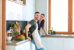 Beautiful young couple is having fun in kitchen at home Stock Image