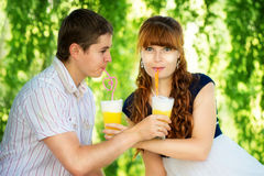 Beautiful Young Couple Having Fun. Picnic in Countryside. Happy Stock Photography