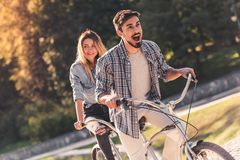 Couple with a tandem bicycle Royalty Free Stock Photography
