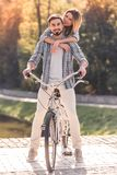 Couple with a tandem bicycle Royalty Free Stock Images