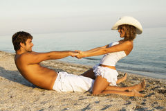 Beautiful young couple having fun on the seashore Royalty Free Stock Photos