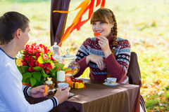 Beautiful Young Couple Having Picnic in autumn Park. Happy Famil Stock Images