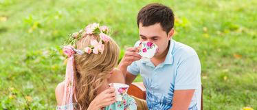 Beautiful Young Couple Having Picnic in Countryside. Happy Family Outdoor. Smiling Man and Woman relaxing in Park Royalty Free Stock Photos