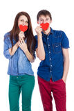 Beautiful young couple holding a small red paper heart in hands Stock Photo